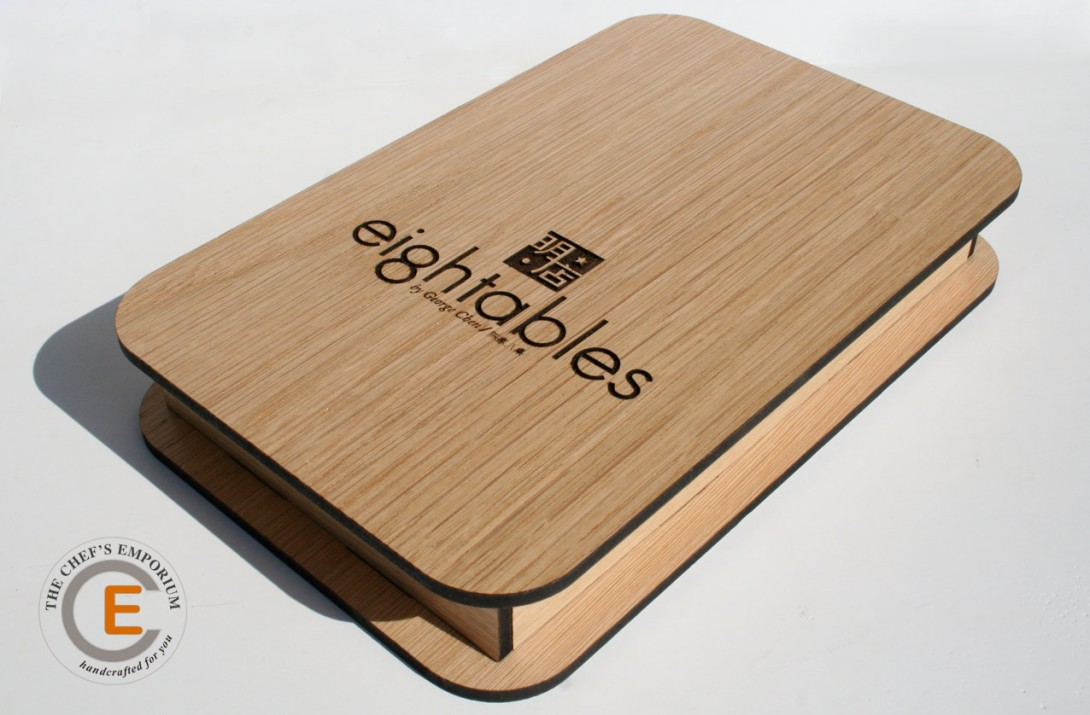 Engraved wooden bill presenter.